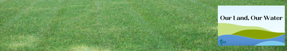 nicely manicured lawn with Our Land Our Water logo on the right side