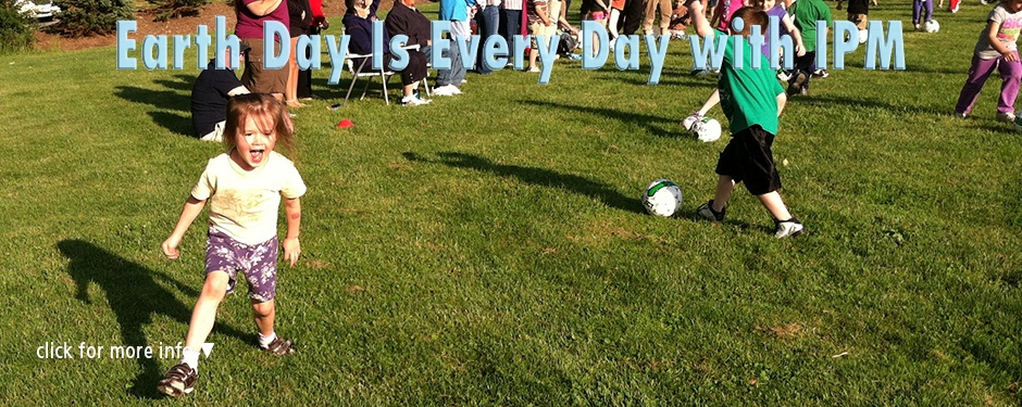 Earth Day with IPM: children playing soccer on an athletic field